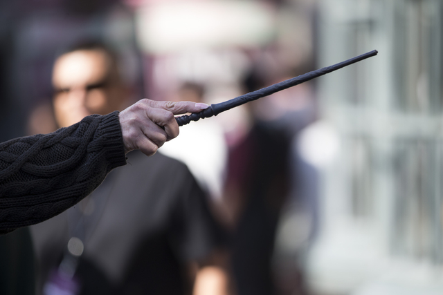 A woman uses her wand to operate an interactive window inside The Wizarding World of Harry Potter at Universal Studios on Friday, March 18, 2016, in Universal City, Calif. Erik Verduzco/Las Vegas  ...