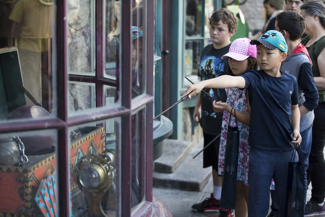 Children use their wands to operate an interactive window inside The Wizarding World of Harry Potter at Universal Studios on Friday, March 18, 2016, in Universal City, Calif. Erik Verduzco/Las Veg ...