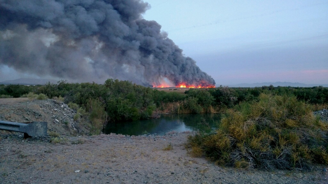 Personnel from the Mohave Valley (Ariz.) Fire District are battling a blaze in the Havasu National Wildlife Refuge that was reported at 4:30 a.m. on Wednesday, April 6, 2016. The fire, which start ...
