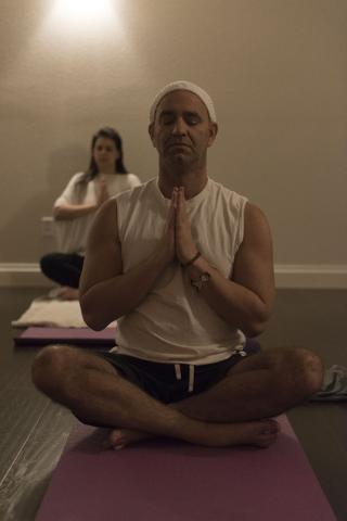 Holistic House Las Vegas founder Justin Hoffman participates in a Kundalini Yoga class at RYK Yoga & Meditation Center March 21. Jason Ogulnik/View