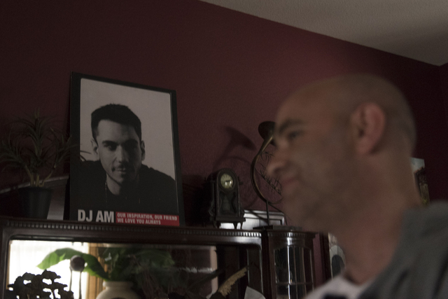 A poster of DJ AM is seen as Holistic House founder Justin Hoffman speaks with a reporter at the house in Henderson March 21. DJ AM was Hoffman's AA sponsor before he died in 2009. Jason Ogulnik/View
