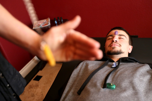 Daniel Brownstein is shown during a raiki session by raiki practitioner Tishara Cousino at Holistic House in Henderson March 29. Rachel Aston/View