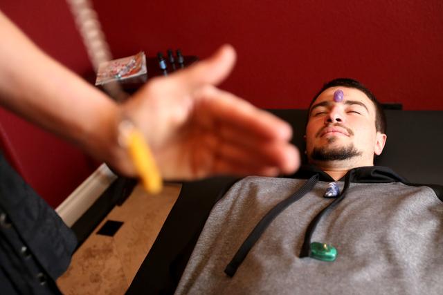 Daniel Brownstein is shown during a raiki session by raiki practitioner Tishara Cousino at Holistic House in Henderson March 29. Rachel Aston/View