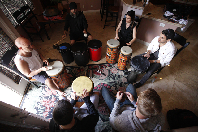 From left, Justin Hoffman, Jeffrey Trower, Tishara Cousino, Julian Mesa, Michael Zurovec and Daniel Brownstein participate in a drum circle at Holistic House in Henderson, March 29. Holistic House ...