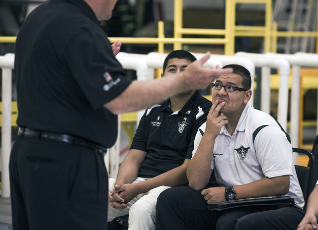 Rancho High School Aviation Academy student Zachary Salazar Jr. listens while Greg Rochna, CEO of Maverick Aviation Group, speaks in the company's hangar at Henderson Executive Airport April 8. Je ...