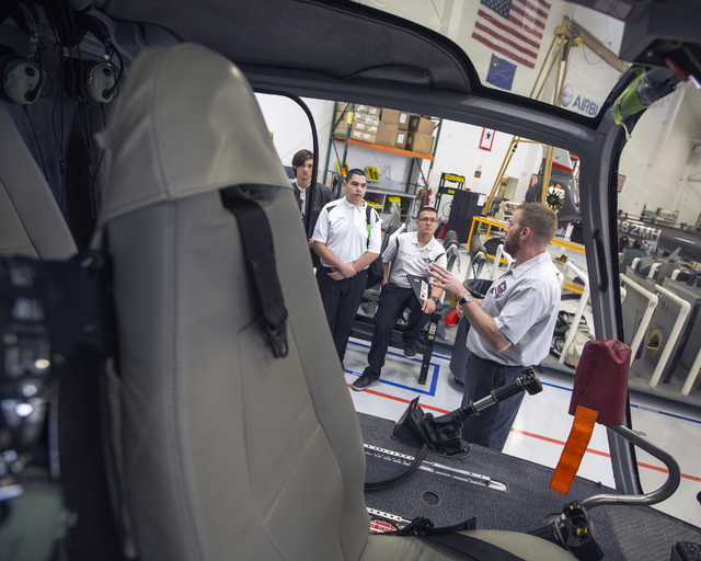 Tim Hoffman, right, quality assurance manager for Maverick Aviation Group, explains the Airbus helicopter to Rancho High School Aviation Academy students at Henderson Executive Airport April 8. Je ...