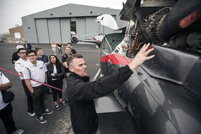 Jim Ogletree, chief pilot with Maverick Aviation Group, explains the Airbus EC130 helicopter to Rancho High School Aviation Academy students at Henderson Executive Airport April 8. Jeff Scheid/Vie ...