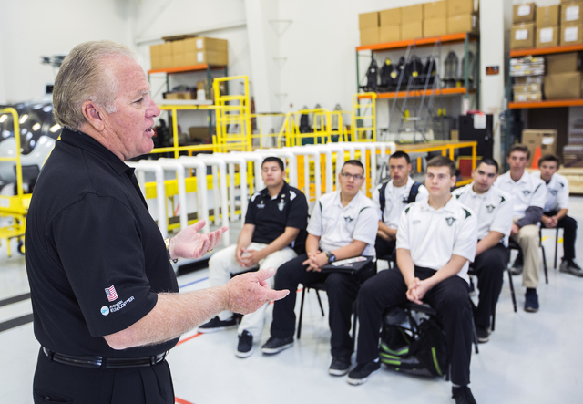 Greg Rochna, CEO of Maverick Aviation Group, speaks to Rancho High School Aviation Academy students in the company's hangar at Henderson Executive Airport April 8. Jeff Scheid/View