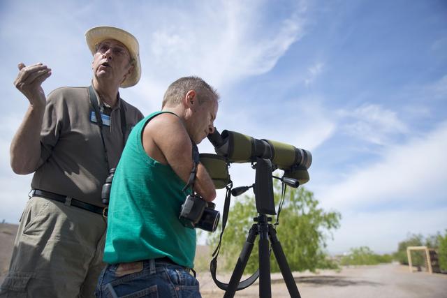 Randy Robbins, right, looks through a spotting scope as John Taylor, lead recreation assistant, speaks April 4 at the Henderson Bird Viewing Preserve. Daniel Clark/View Follow @DanJClarkPhoto