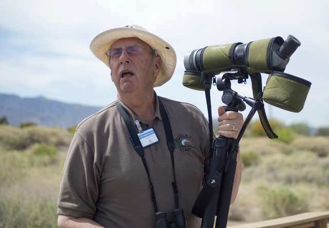John Taylor, lead recreation assistant at the Henderson Bird Viewing Preserve, sets up a spotting scope April 4 at the facility. Daniel Clark/View Follow @DanJClarkPhoto