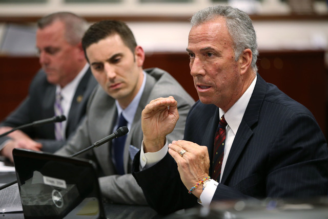 From left, Douglas County District Attorney Mark Jackson, Assistant Attorney General Wes Duncan and Clark County District Attorney Steve Wolfson testify in a hearing at the Legislative Building in ...