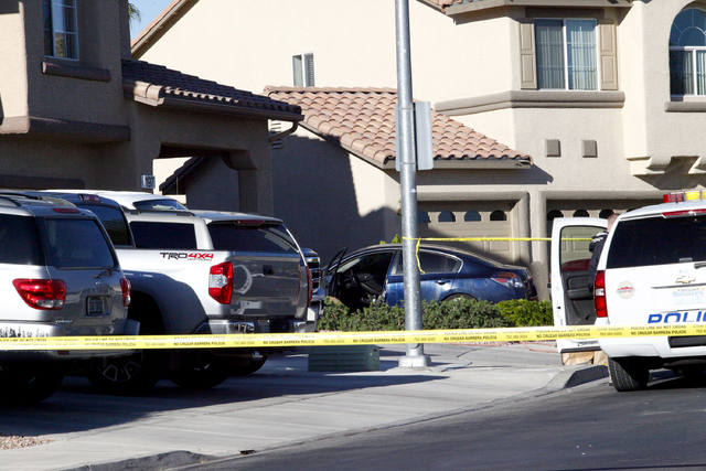 Henderson police investigate a shooting and car crash that left two men dead just after midnight Tuesday, April 12, 2016, in the 100 block of Trenier Drive. (Michael Quine/Las Vegas Review-Journal ...