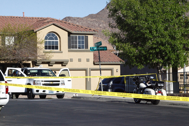 Henderson police investigate a shooting and car crash that left two men dead just after midnight Tuesday, April 12, 2016, at the corner of Trenier Drive and Ridgegate Street. (Michael Quine/Las Ve ...