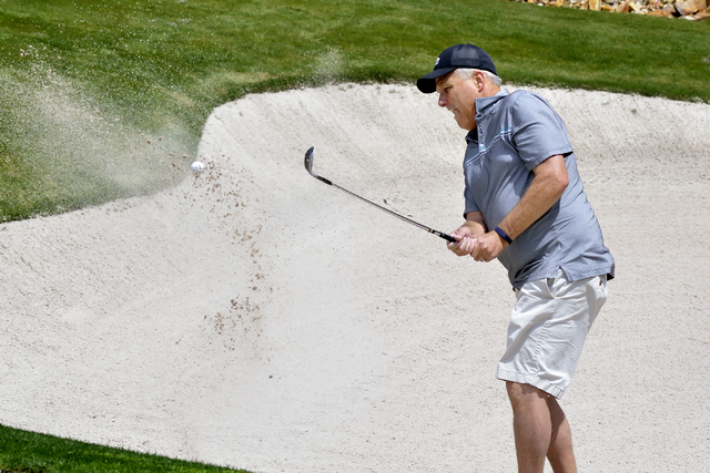 Las Vegan Dave Argier blasts out of a sand trap at the Cascata Golf Course at 1 Cascata Drive in Boulder City on Thursday, April 21, 2016. Bill Hughes/Las Vegas Review-Journal