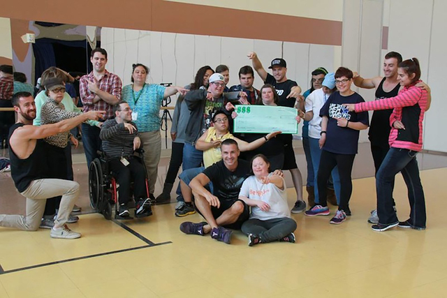 Opportunity Village OVIPs posed with the Aussie Hunks after the Las Vegas strip show presented the organization a donation at Opportunity Village's Engelstad campus on March 29. Special to View.