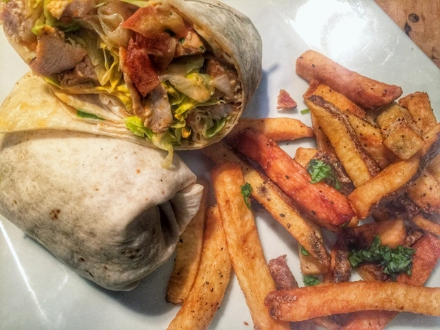 A Buffalo chicken wrap is shown at Hi Scores, 4785 Blue Diamond Road. Fernando Lopez/Special to View