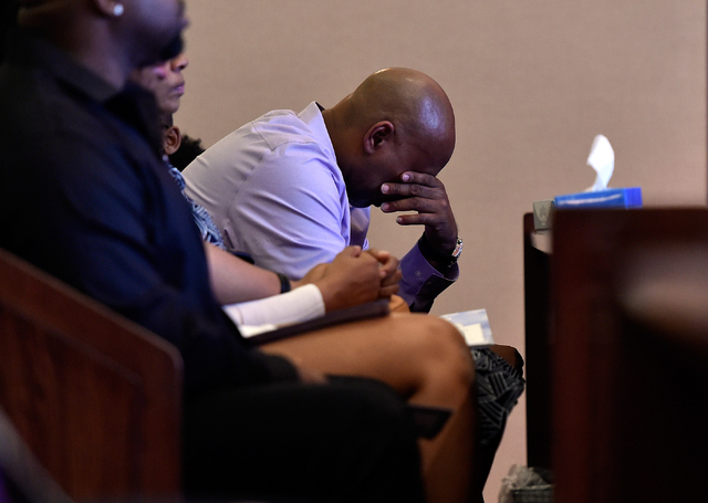 Juan Talley, the father of Felicia Hughes-Wimberly's first daughter, leans forward as he attends her funeral at Palm Mortuary on Friday, April 8, 2016. Hughes-Wimberly and her son, Branden Hughes, ...