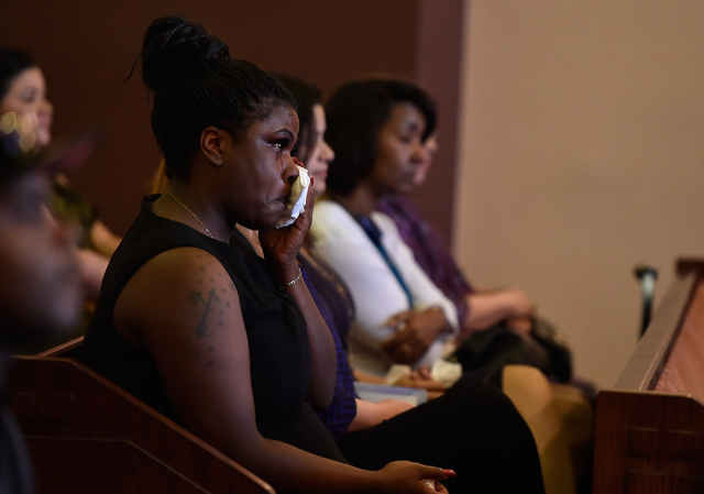 A guest wipes her tears as she attends the funeral service for Felicia Hughes-Wimberly at Palm Mortuary on Friday, April 8, 2016. Hughes-Wimberly and her son, Branden Hughes, were killed at a neig ...