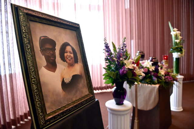 A picture of Branden Hughes and his mother Felicia Hughes-Wimberly is displayed with flowers during the funeral service for Hughes-Wimberly at Palm Mortuary on Friday, April 8, 2016. The mother an ...