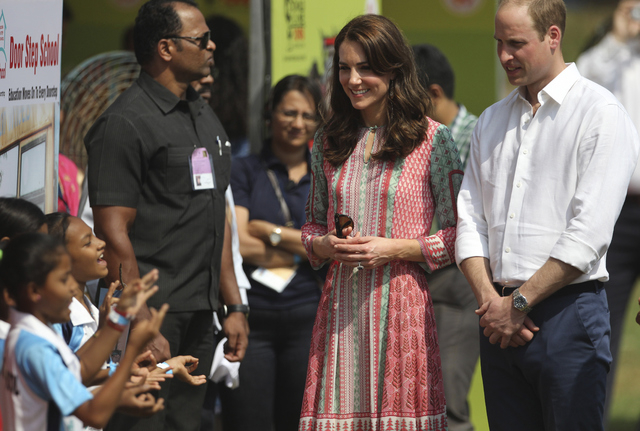 The Duke and Duchess of Cambridge, Prince William, and his wife, the former Kate Middleton, listen to Indian children sing a song during a charity event at the Oval Maidan in Mumbai, India, Sunday ...