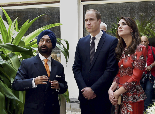 The Duke and Duchess of Cambridge, Prince William, center and his wife, the former Kate Middleton, arrive to lay a wreath on the martyrs memorial at the Taj Mahal Palace Hotel in Mumbai, India, Su ...