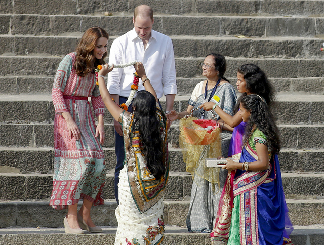The Duke and Duchess of Cambridge, Prince William, and his wife, the former Kate Middleton, are garlanded as they arrive at the Banganga Water Tank in Mumbai, India, Sunday, April 10, 2016. (Rajan ...