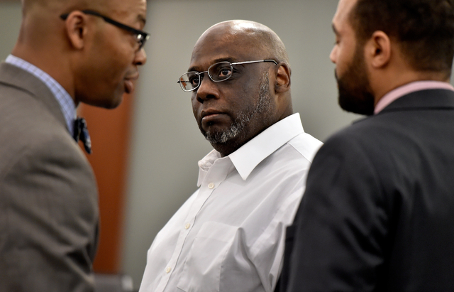 Billy Ray James, center, looks to his attorney, Jonathan MacArthur, left, and assistant Clarence Patterson as he waits for the verdict during his trial at the Regional Justice Center Tuesday, Apri ...