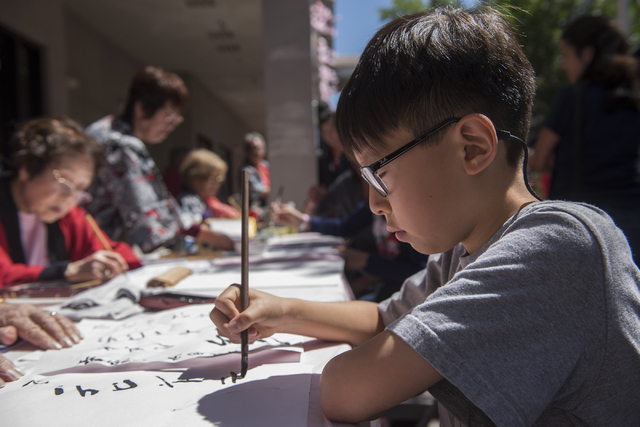 Kevin Lee, 9, practices calligraphy during a Japanese Spring Festival presented by the local Kizuna Japanese Society on Saturday, April 16, 2016, in Las Vegas. Martin S. Fuentes/Las Vegas Review-J ...