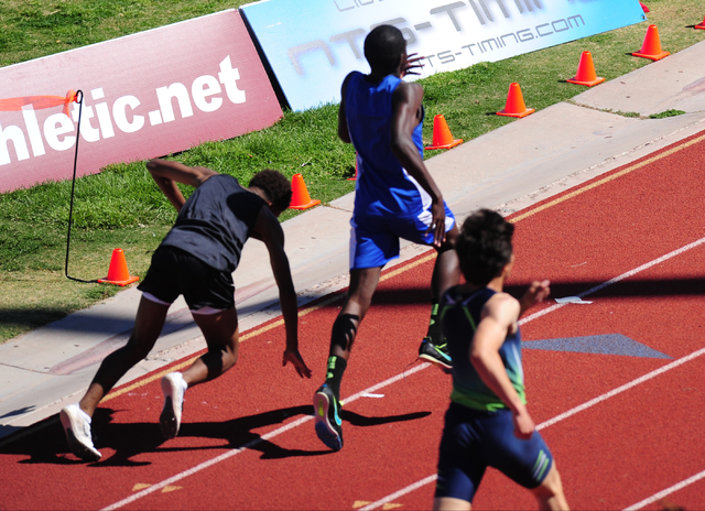 Palo Verde's Christian Jackson, left, falls near the finish line while racing Sierra Vista's Ronald Stephenson in the 400 meter dash at the Skyhawk Invitational track and field meet at Silverado H ...