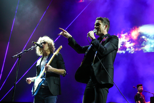 Brandon Flowers, right, and Dave Keuning of The Killers perform during the grand opening of the T-Mobile Arena in Las Vegas on Wednesday, April 6, 2016. Chase Stevens/Las Vegas Review-Journal Foll ...
