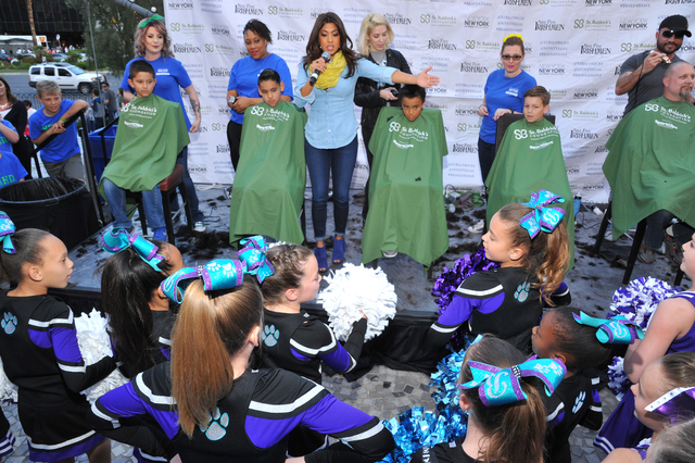 KTNV TV personality Megan Telles cheers on a group of 36 students from Bonner Elementary School, which raised $15,000 for St. Baldrick's Foundation on St. Patrick's Day. From lefet,  ...