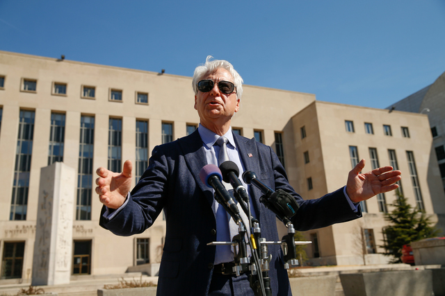 Attorney Larry Klayman speaks to reporters outside the Barrett Prettyman Federal Courthouse in Washington, Thursday, April 2, 2015. (AP Photo/Andrew Harnik)