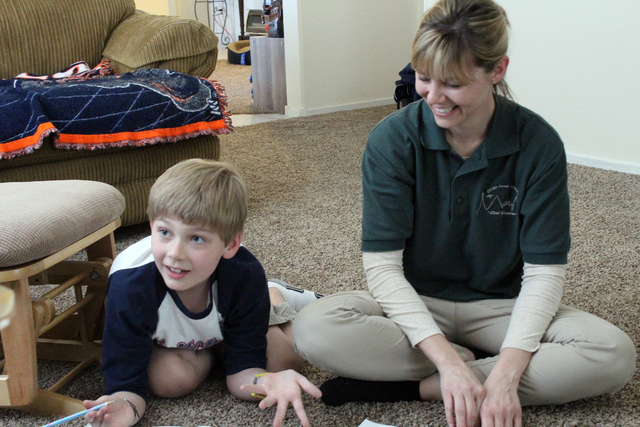 Larson Foster, 8, and his mother, Deanne, are shown in their Henderson home April 5. The family is trying to raise awareness about pediatric strokes after Larson suffered four within a year. Micha ...