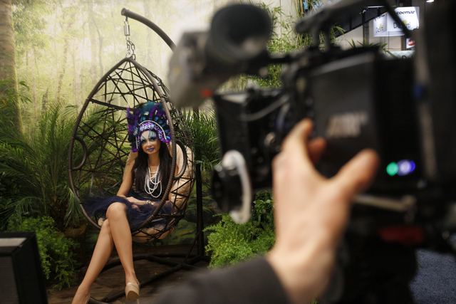 Model Jamillette Gaxiola poses for the cameras at the Zeiss lenses booth in the showroom at the National Association of Broadcasters conference at the Las Vegas Convention Center Tuesday, April 19 ...