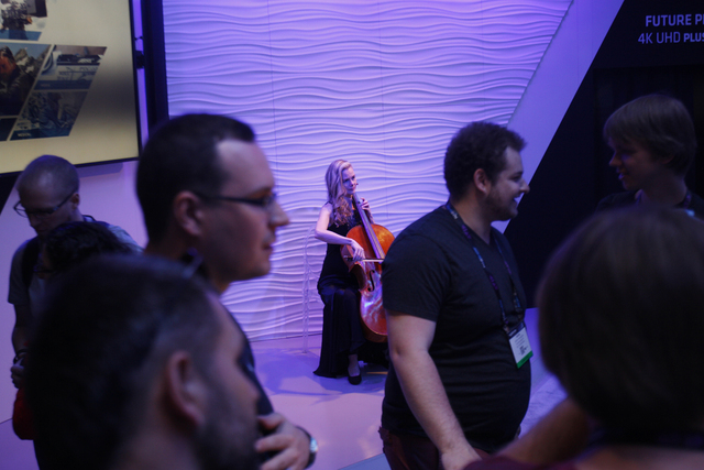 Sarah O'Brien plays the cello at the Arri lighting booth in the showroom at the National Association of Broadcasters conference at the Las Vegas Convention Center Tuesday, April 19, 2016. Rachel A ...