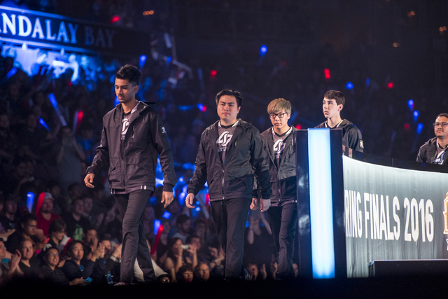 Counter Logic Gaming team members enter the arena before facing off against TSM during the North America League of Legends Championship Series Spring Final at the Mandalay Bay Event Center in Las  ...