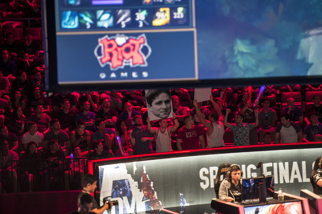 Fans hold up signs as Counter Logic Gaming battles against TSM during the North America League of Legends Championship Series Spring Final at the Mandalay Bay Event Center in Las Vegas on Sunday,  ...