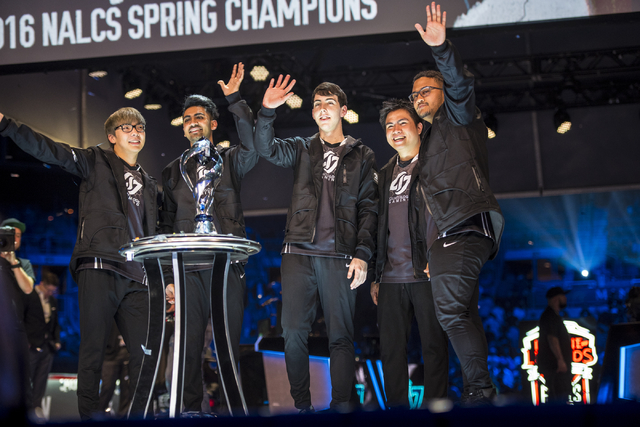 Counter Logic Gaming celebrates after defeating TSM during the North America League of Legends Championship Series Spring Final at the Mandalay Bay Event Center in Las Vegas on Sunday, April 17, 2 ...