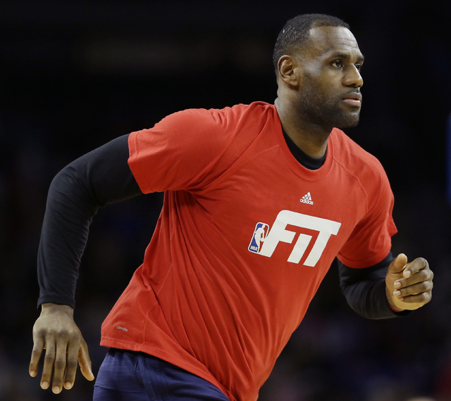 Cleveland Cavaliers forward LeBron James warms up before the second half against the Detroit Pistons in Auburn Hills, Mich., in January. (Carlos Osorio/The Associated Press)