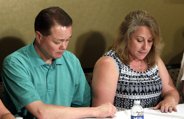 Lee's Discount Liquor robbery victim Matthew Christensen's mother, Theresa and her husband, Dennis pause as they speak about the death of their son as they address the media at Excalibur hotel-cas ...