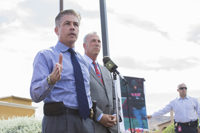 Metro homicide Lt. Dan McGrath, left, with Clark Country District Attorney Steven Wolfson, right, answers questions at the site of a fatal shooting that took place Monday night at Lee's Discount L ...