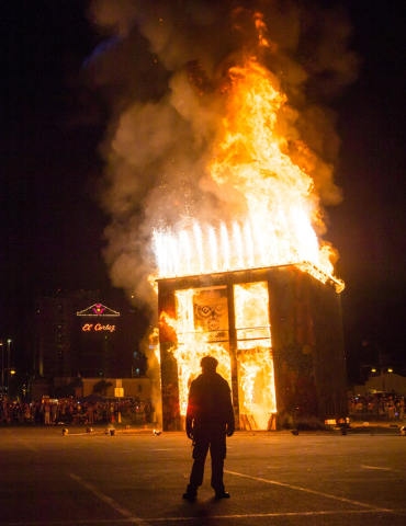 A Life Cube fire crew member is silhouetted as the fire ceremony goes on for the Life Cube in downtown Las Vegas on Saturday, April 2, 2016. (Chase Stevens/Las Vegas Review-Journal) Follow @csstev ...
