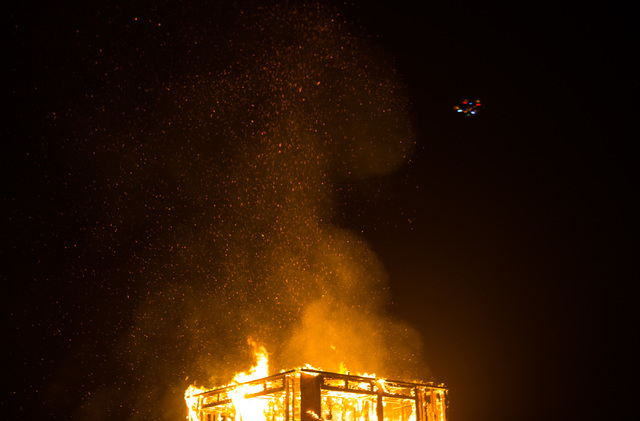 The fire ceremony goes on for the Life Cube in downtown Las Vegas on Saturday, April 2, 2016. (Chase Stevens/Las Vegas Review-Journal) Follow @csstevensphoto