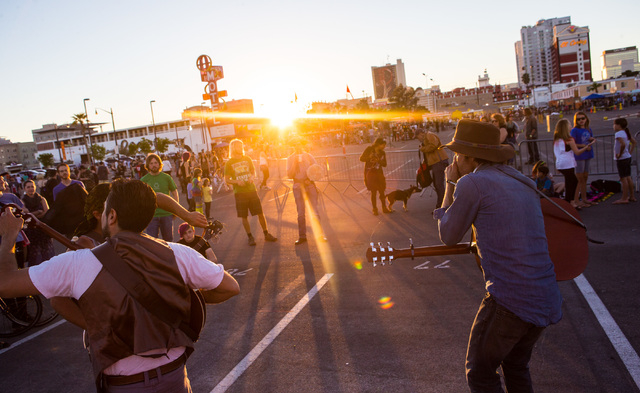 Musicians perform as the sun sets before the Life Cube fire ceremony in downtown Las Vegas on Saturday, April 2, 2016. (Chase Stevens/Las Vegas Review-Journal) Follow @csstevensphoto