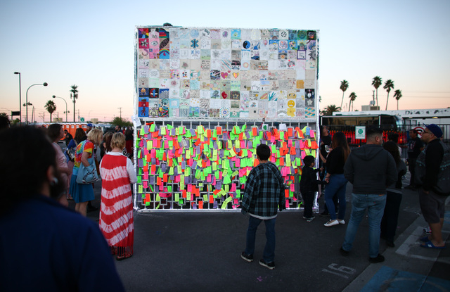 People look at an art installation before the Life Cube fire ceremony in downtown Las Vegas on Saturday, April 2, 2016. (Chase Stevens/Las Vegas Review-Journal) Follow @csstevensphoto