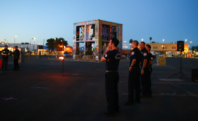 Firefighters prepare for the start of the Life Cube fire ceremony in downtown Las Vegas on Saturday, April 2, 2016. (Chase Stevens/Las Vegas Review-Journal) Follow @csstevensphoto