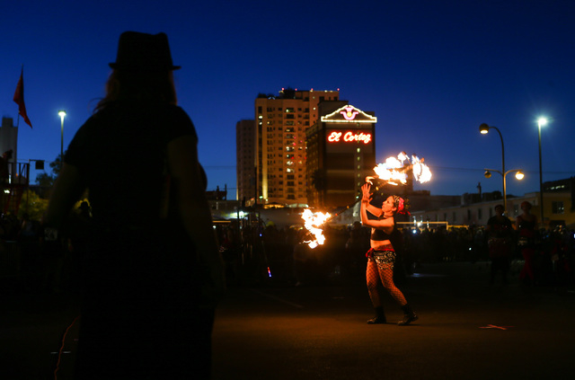 A member of Flameology performs before the start of the Life Cube fire ceremony in downtown Las Vegas on Saturday, April 2, 2016. (Chase Stevens/Las Vegas Review-Journal) Follow @csstevensphoto