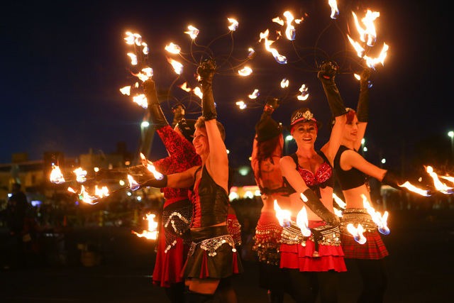 Members of Flameology perform before the start of the Life Cube fire ceremony in downtown Las Vegas on Saturday, April 2, 2016. (Chase Stevens/Las Vegas Review-Journal)Follow @csstevensphoto