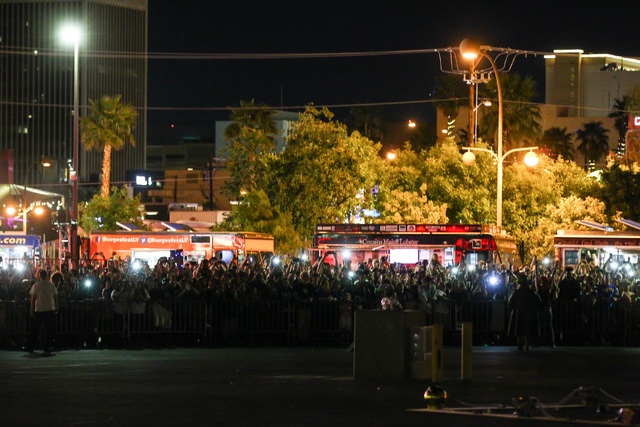 People wait for the start of the Life Cube fire ceremony in downtown Las Vegas on Saturday, April 2, 2016. (Chase Stevens/Las Vegas Review-Journal) Follow @csstevensphoto