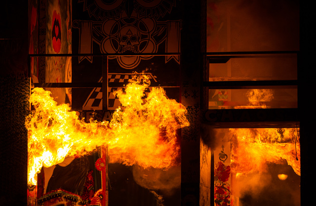 The fire ceremony goes on for the Life Cube in downtown Las Vegas on Saturday, April 2, 2016. (Chase Stevens/Las Vegas Review-Journal)Follow @csstevensphoto